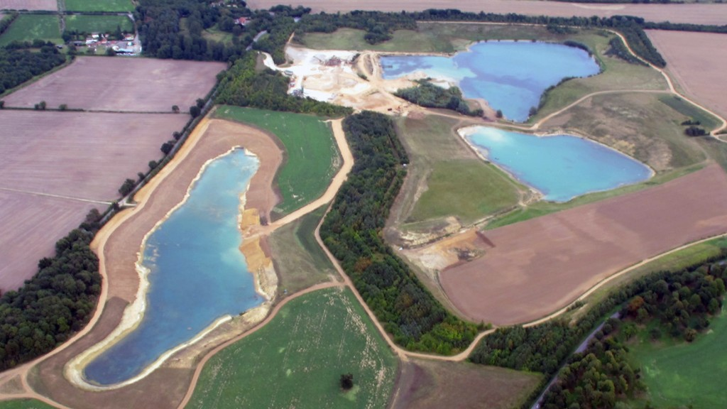 An aerial photograph of St Genevieve's Lake in Suffolk, East Anglia